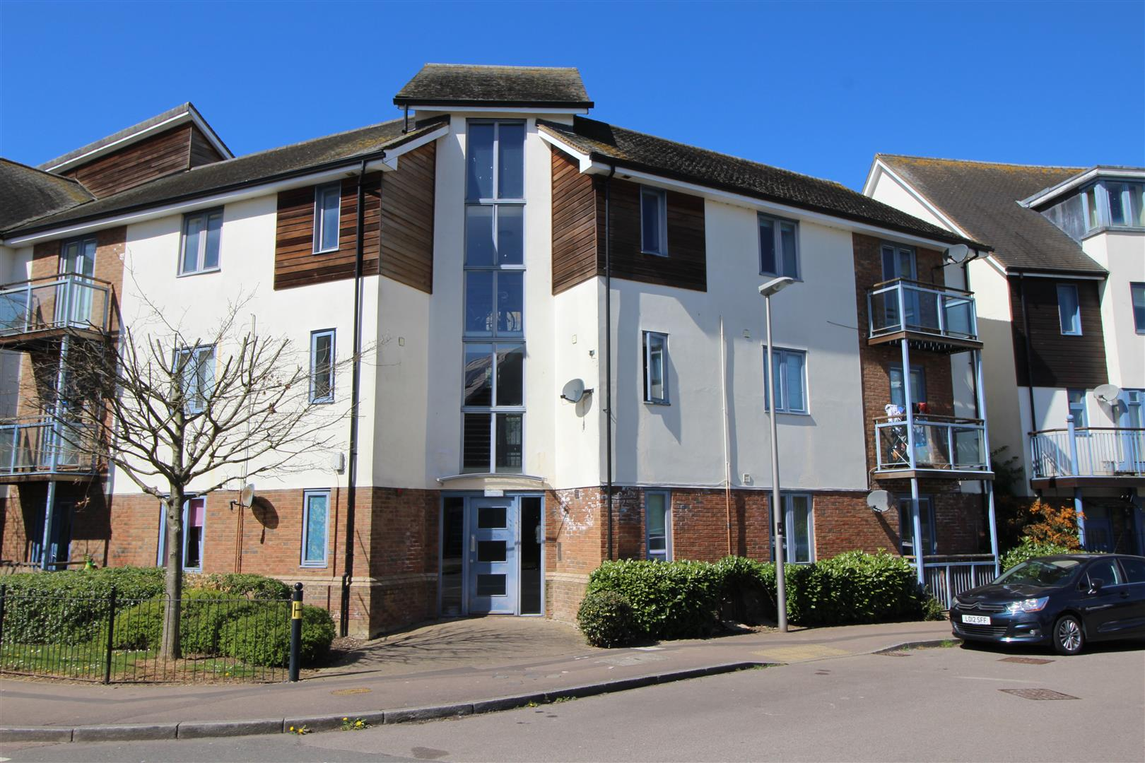 EXCELLENT LOCATION OVERLOOKING OPEN GRASS LAND AND THE BROUGHTON BROOK TO THE FRONT whilst only a short walk from the local centre. Newly decorated and re-carpeted 2 bedroom top floor apartment with a balcony from the lounge overlooking the park land and